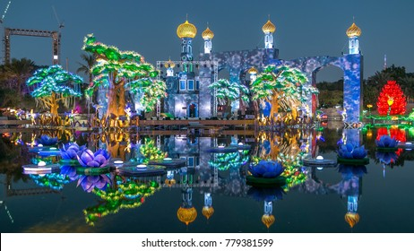 Lake with flowers and castle. Newly opened Dubai Glow Garden day to night transition timelapse is a state of Art architecture featuring environment friendly architecture, creating various structures