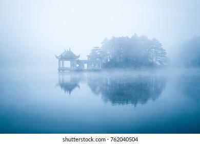 lake in fog, beautiful lushan mountain landscape, China