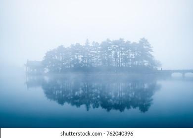 lake in fog, beautiful mount lu scenic area landscape, China