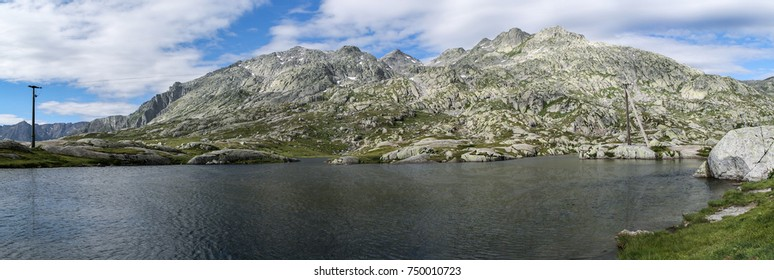 A lake at the foot of some Alpine mountains in Austria at the Gotthard mountain pass