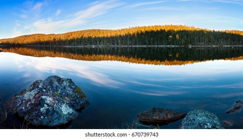 Lake in a forest in autumn in Finnish Lapland