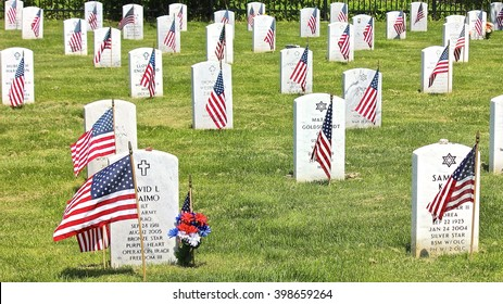 Lake Forest, IL, USA - May 23, 2015: A Memorial Day (Decoration Day) view at Fort Sheridan Cemetery of tombstones decorated with American flags, engraved with Christian Cross, Jewish Star of David.