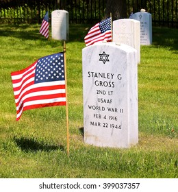 Lake Forest, IL, USA - May 23, 2015: Memorial Day (Decoration Day) weekend view of an American flag at the Fort Sheridan Cemetery tombstone of a World War II U.S. Army Air Force 2nd Lieutenant.