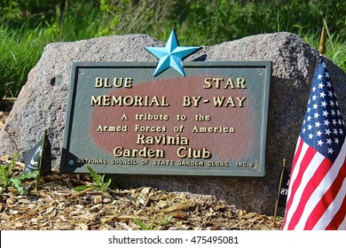 """Lake Forest, IL, USA - May 21, 2015: A Blue Star Memorial By-Way marker at entrance road to Fort Sheridan Cemetery: """"A tribute to the Armed Forces of America, Ravinia Garden, National Council  ... """""""