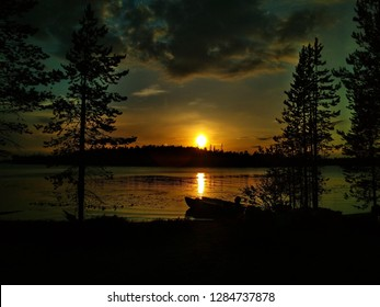 lake and forest at sunset in north karelia in russia
