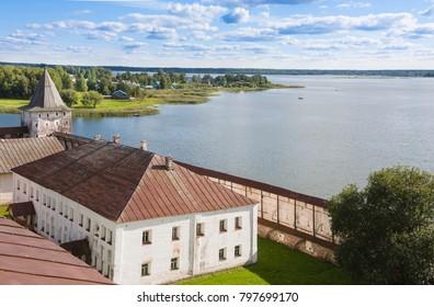 Lake, fortress tower and wall of Kirillo-Belozersky monastery near City Kirillov, Vologda region, Russia