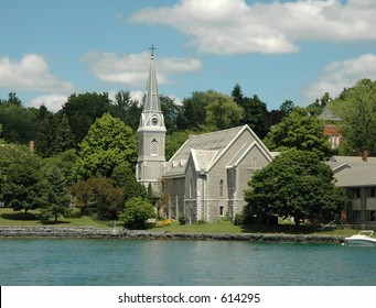 Lake front Church with Steeple and clock tower.  Skaneateles Lake, Finger Lakes Region, Upstate New York.