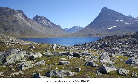 Lake in front of mountains in Jotunheimen National Park Norway
