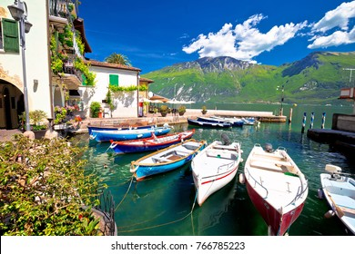 Lake Garda in town of Limone sul Garda waterfront view,colorful boats, Lombardy region of Italy