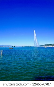"Lake of Geneva Switzerland with its ""Jet d'Eau"" or large fountain spraying out of the lake 140 meters or 460 feet high the cities most famous landmark"
