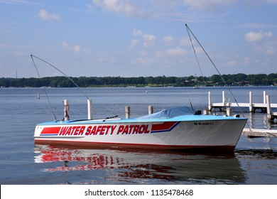 Lake Geneva, Wisconsin / USA - July 16, 2018: The Geneva Safety Water Patrol boat docked on a sunny summer day.