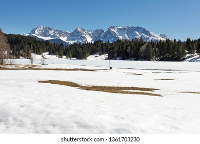 Lake Geroldsee (Wagenbruechsee) in early springtime with view to the Karwendel mountains