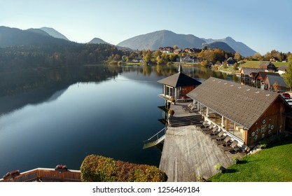 Lake Grundlsee in the fall during the sunrise. View of the Alps. Village Grundlsee, region Salzkammergut, federal state of Styria, Austria, Europe.
