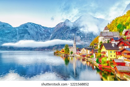 Lake Hallstatt, Austria. Hallstatt village on the bank of Hallstatter lake in High  Alps mountains. Picturesque sunrise dawn scenery with glowing sun. Autumn season. UNESCO world heritage site.