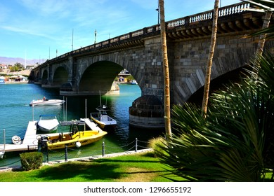 Lake Havasu, Arizona / USA - March 17, 2014:  A view of the London Bridge with boats in the foreground on a beautiful spring day.