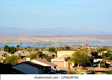 Lake Havasu in the distance from a neighborhood area looking outward and downward.