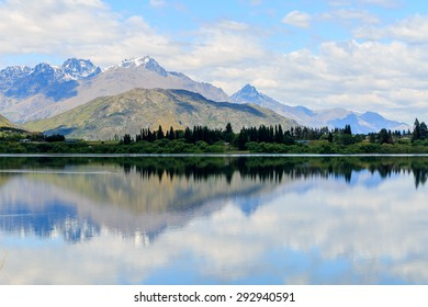 Lake Hayes located in Otago Region, Queenstown, South Island, New Zealand. This shot taking in summer showing its reflection of the Lake and vibrant colour.