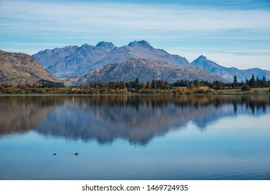 Lake Hayes in New Zealand south island beautiful reflection in early autumn