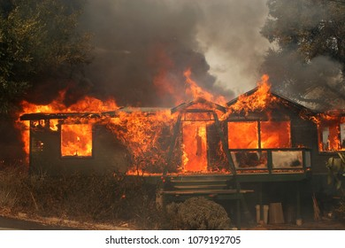 Lake Hodges, CA/USA - Oct 23, 2007: A house burns down during the Harris Ranch fire around Lake Hodges. The wildfire destroyed 200 homes and killed one civilian.