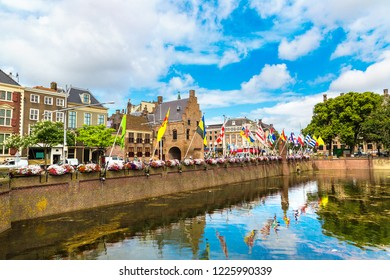 Lake Hofvijver with flags near Binnenhof palace in Hague in a beautiful summer day, The Netherlands