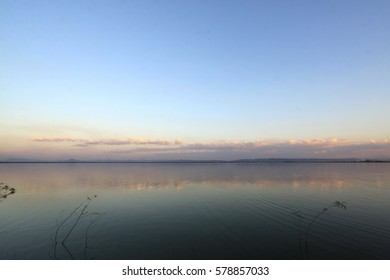 The lake at horizon  evening sky.