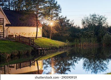 Lake house with sunset light