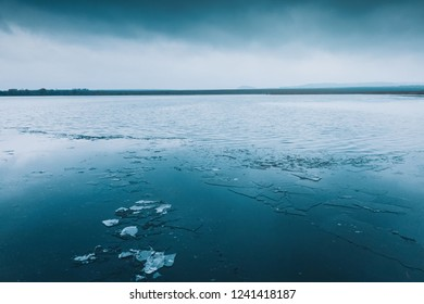 Lake with ice. Winter landscape
