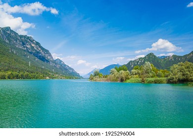 Lake Idro Italy. Nature landscape for adventure, hiking and recreational tourism. Blue water and sky, summertime.
