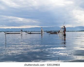 Lake Inle, Myanmar - Circa December 2016 - Traditional fishermen on Lake Inle