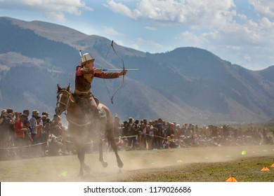 Lake Issyk-Kul, Kyrgyzstan, 6th September 2018: man competing in archery on horseback game