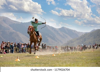 Lake Issyk-Kul, Kyrgyzstan, 6th September 2018: Woman competing in archery on horseback game