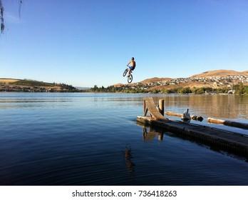 Lake jump mountain biking in Vernon, BC