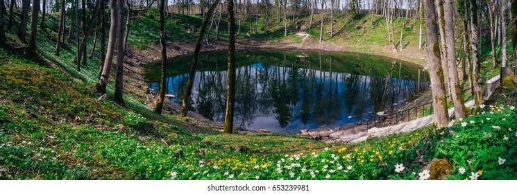 Lake in Kaali meteorite crater by springtime. Saaremaa island, Estonia
