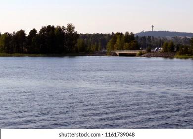 Lake Kallavesi, Kuopio Finland. Puijo tower and ski jumping hill on background.