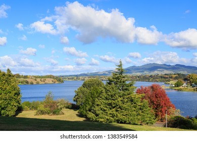 Lake Karapiro, New Zealand, a Man-Made Lake Behind a Dam on the Waikato River. Calm Weather and Autumn Leaves