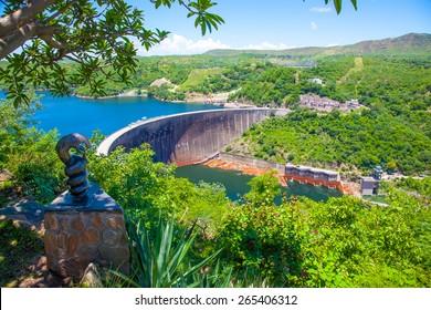 Lake Kariba dam wall and a statue of nyami nyami the river snake god.  Zambezi river.  Zimbabwe Africa.