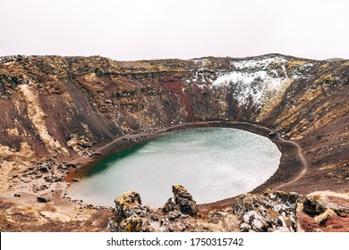 Lake Kerid is a crater lake or volcanic lake, in the crater of a volcano in Iceland. Unusual red soil, similar to the Martian landscapes.
