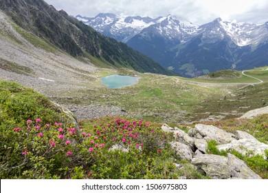 Lake Klaussee below the Rauchkofel peak in Aurina Valley in South Tyrol, Italy