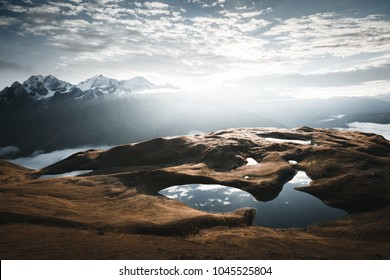Lake Koruldi near Mt. Ushba. Location Upper Svaneti, Georgia country, Europe. Main Caucasian ridge. Scenic image of beautiful nature landscape, amazing mountain view. Explore the beauty of earth.