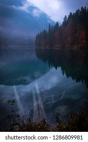 Lake Laghi di Fusine with beautiful reflections on a rainy evening near Tarvisio in Italy, Europe