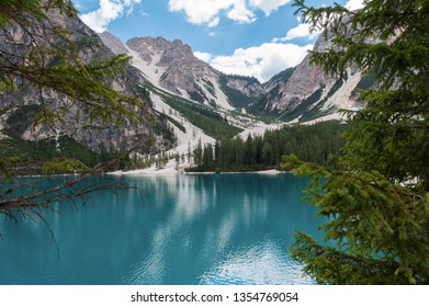 Lake Lago di Braies in Dolomiti mountains, South Tyrol, Italy. Amazing view of Lago di Braies (Braies lake, Pragser wildsee) at sunset light. Blue water between Alps mountains and deep forest.