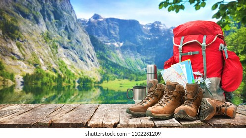lake landscape with big backpack and trekking boots in mountains