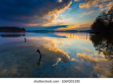 Lake landscape photographed at colorful sunset. Lake Krzywe in Olsztyn, Mazury lake district