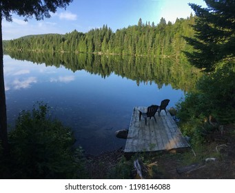a lake is like a miror in the summer of Quebec, Canada