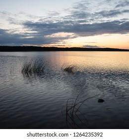 Lake Linowskie on sunset. Lake in Linowo, Mazury, Poland. Calm day, blue skies, beautiful colors. Landscape of a polish masuria region.