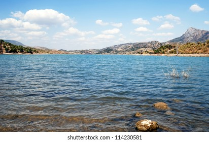 Lake located in the town of Zahara de la Sierra in the Spanish province of Cadiz, is the coast and mountain scenery , image taken in a summer day