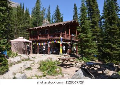 LAKE LOUISE, AB / CANADA - JULY 26, 2017:  Tourists enjoy some food at the Plain of Six Glaciers Tea House near the end of the Plain of Six Glaciers trail.