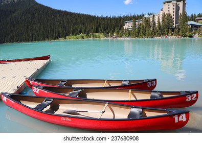 LAKE LOUISE, CANADA - JULY 27:Canoes on beautiful turquoise Lake Louise on July 27, 2014. Lake Louise is the second most-visited destination in the Banff National Park.