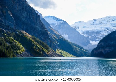 Lake Louise and canoe in autumn, Banff National Park, Canadian Rockies, Alberta, Canada
