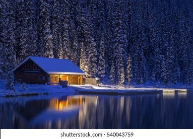 Lake Louise Canoe Rental Log Cabin reflected in Lake Louise Water on a Cold Winter Night in Banff National Park, Rocky Mountains Alberta Canada